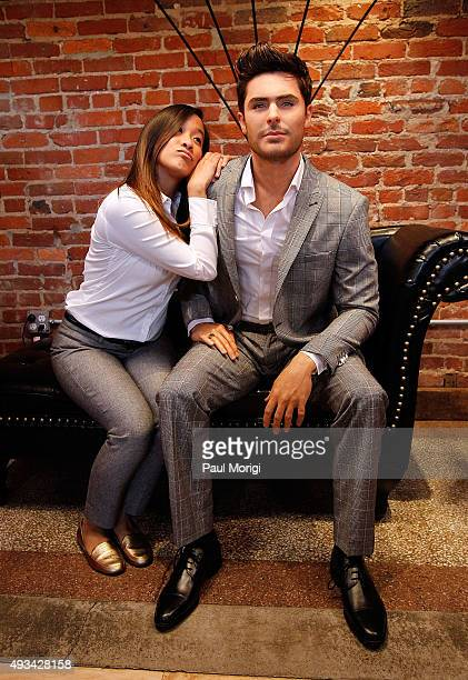 A fan poses for a photo with a Madame Tussauds Washington DC never before seen wax figure of Zac Efron at The Loft at 600 F on October 20 2015 in...