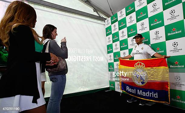 A fan poses for a picture at the 2015 UEFA Champions League Trophy Tour presented by Heineken exhibition on April 18 2015 in Dallas Texas