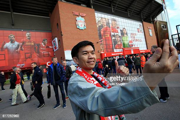 A fan poses for a selfie ahead of the Premier League match between Liverpool and West Bromwich Albion at Anfield on October 22 2016 in Liverpool...