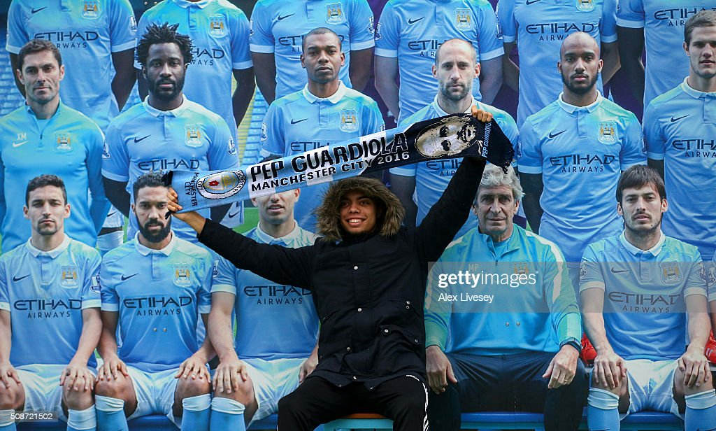 A fan poses in front of a Manchester City team group prior to the Barclays Premier League match between Manchester City and Leicester City at the Etihad Stadium on February 6, 2016 in Manchester, England.