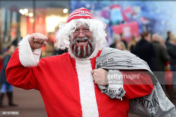 A fan poses in his Christmas outfit ahead of the Barclays Premier League match between Stoke City and Crystal Palace at Britannia Stadium on December...