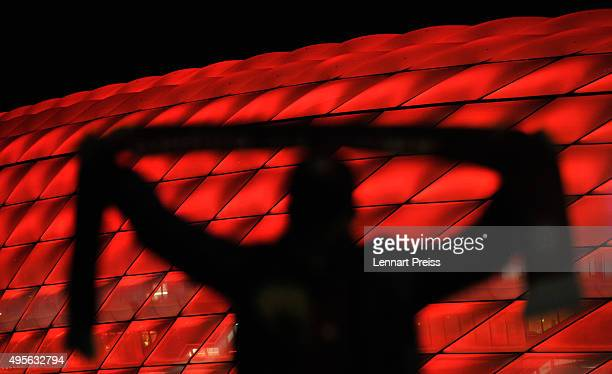 A fan poses outside the stadium prior to the UEFA Champions League Group F match between FC Bayern Muenchen and Arsenal FC at the Allianz Arena on...