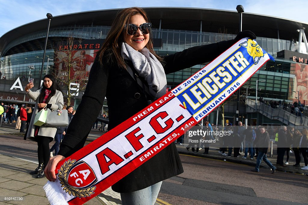 A fan poses with a scarf outoside the stadium before the Barclays Premier League match between Arsenal and Leicester City at Emirates Stadium on February 14, 2016 in London, England.