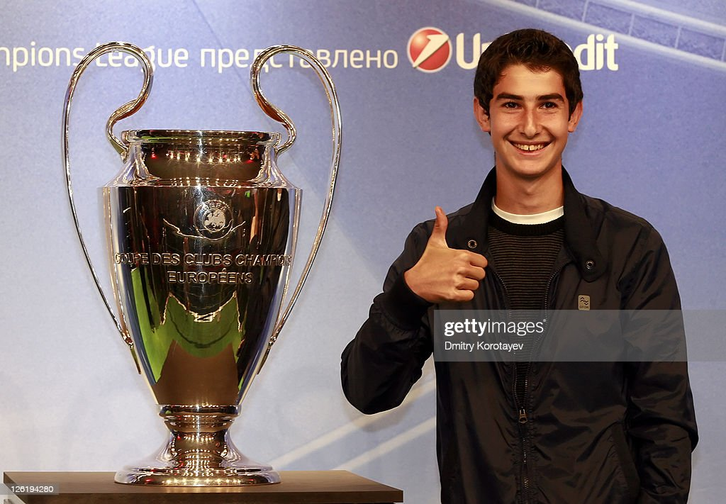 A fan poses with the trophy as he attends the UEFA Champions League Trophy Tour 2011 on September 23, 2011 in Moscow, Russia.