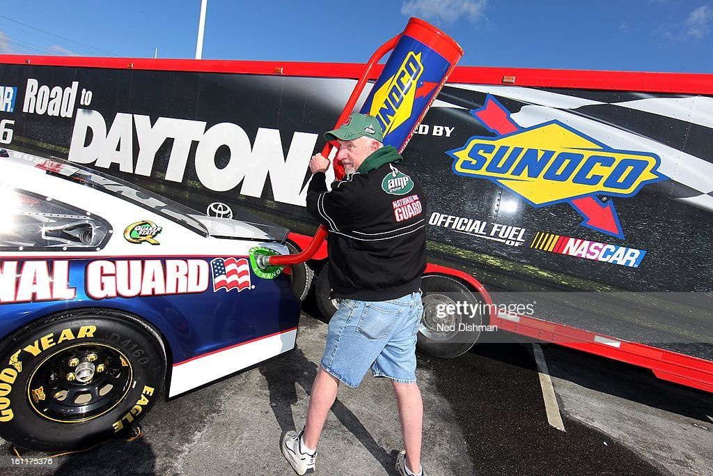 A NASCAR fan pretends to put fuel in the next generation racecar during a Road to Daytona Fueled By Sunoco Tour stop at the Sunoco Station on February 9, 2013 in Newark, Delaware.