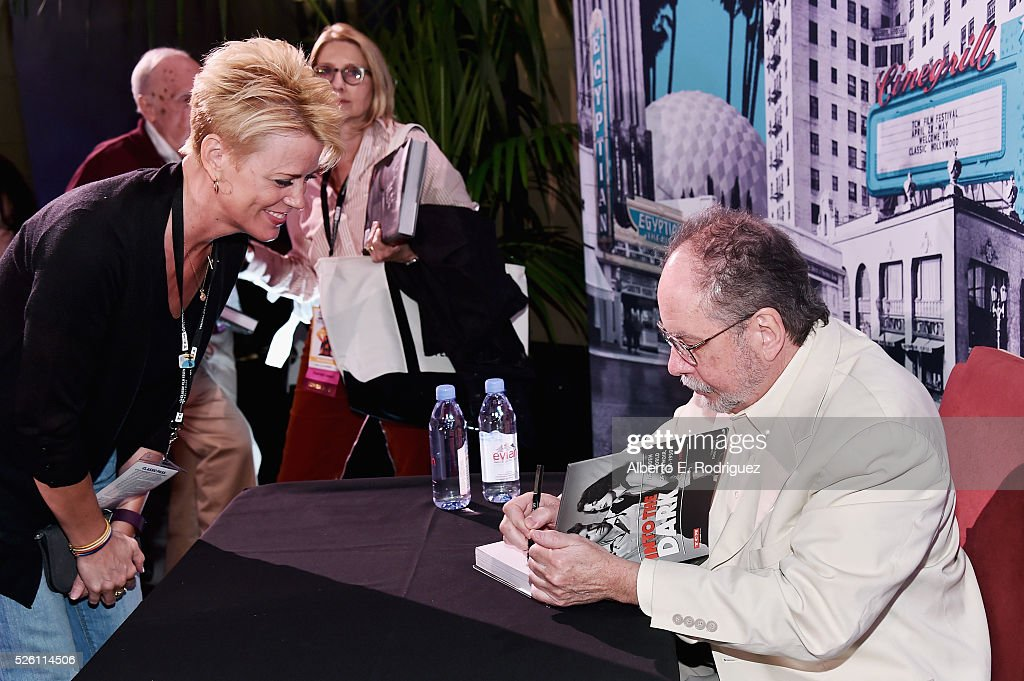 Fan programmer Michelle Curtis (L) and author Mark A. Vieira attend Mark Viera book signing during day 2 of the TCM Classic Film Festival 2016 on April 29, 2016 in Los Angeles, California. 25826_006