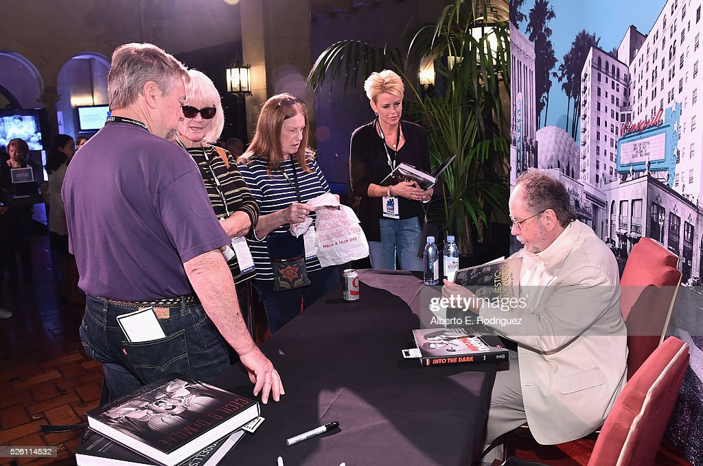 Fan programmer Michelle Curtis (2nd from right) and author Mark A. Vieira attend Mark Viera book signing during day 2 of the TCM Classic Film Festival 2016 on April 29, 2016 in Los Angeles, California. 25826_006