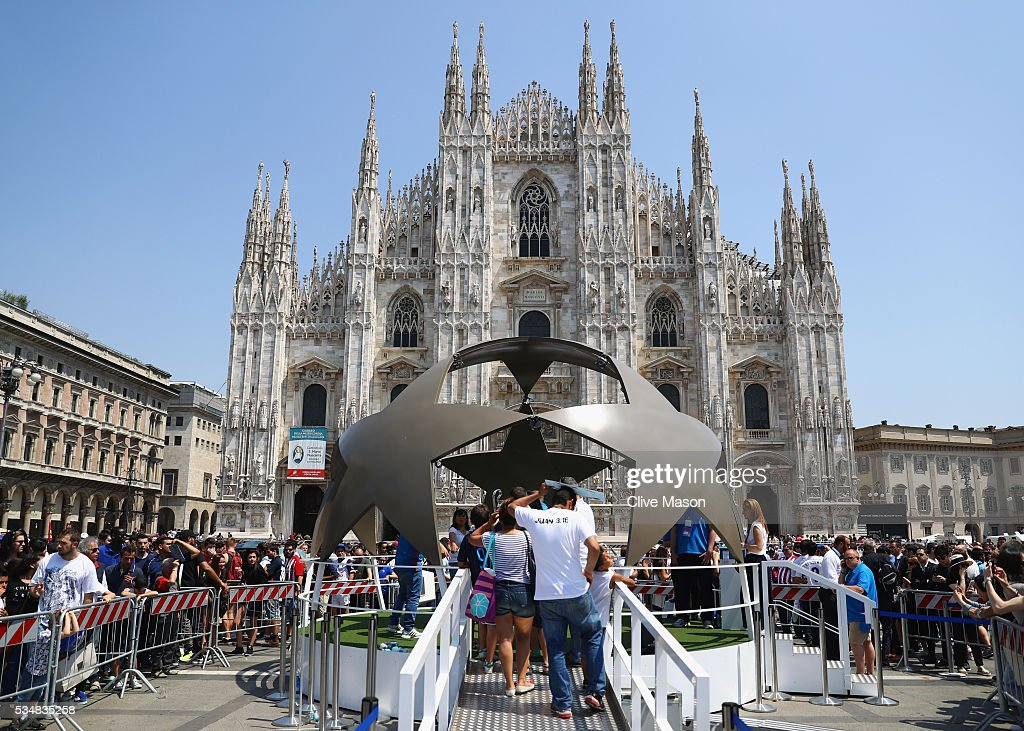 Fan queue to pose with the Champions League trophy at Piazza Duomo ahead of the UEFA Champions League Final match between Real Madrid and Club Atletico de Madrid at Stadio Giuseppe Meazza on May 28, 2016 in Milan, Italy.