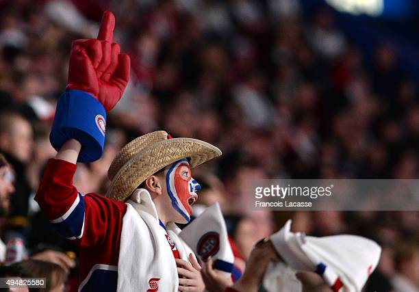 Fan rallies the team of the Montreal Canadiens during the NHL game against the Toronto Maple Leafs in the NHL game at the Bell Centre on October 24...