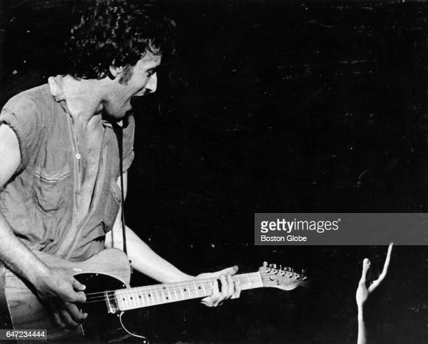 A fan reaches out for Bruce Springsteen during a concert at the Boston Garden in Boston on Sep 25 1978
