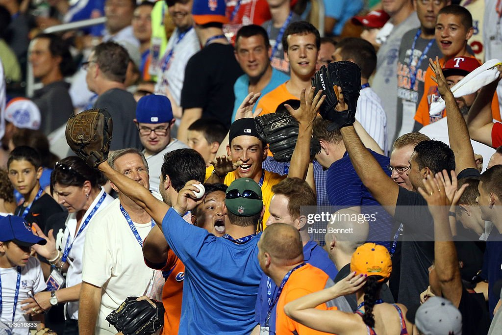 A fan reacts after catching a ball during the Chevrolet Home Run Derby on July 15, 2013 at Citi Field in the Flushing neighborhood of the Queens borough of New York City.