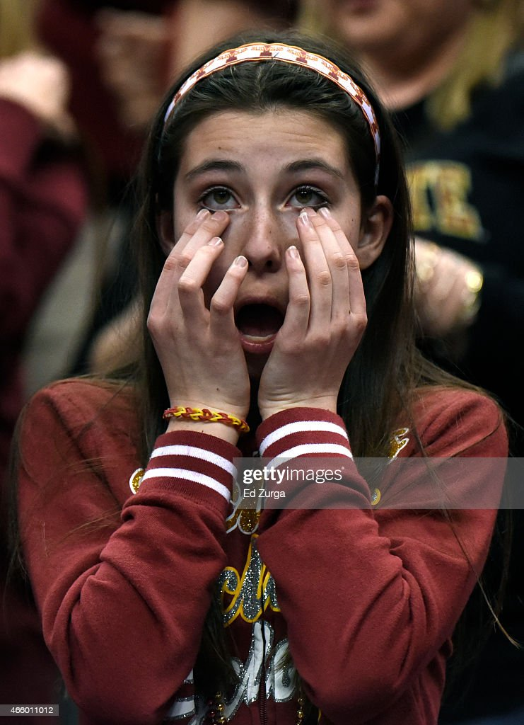 A fan reacts after Iowa State beat Texas Longhorns 69-67 during the quarterfinal round of the Big 12 basketball tournament at Sprint Center on March 12, 2015 in Kansas City, Missouri.