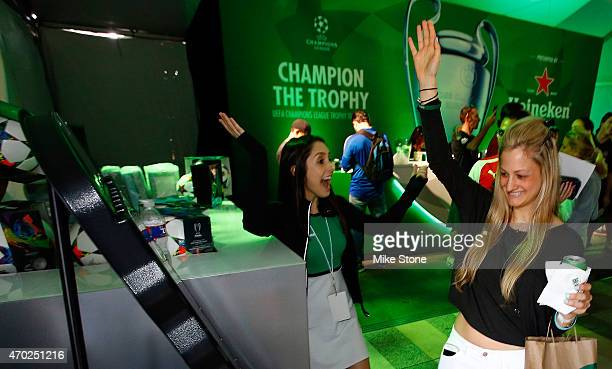 A fan reacts after winning a prize at the 2015 UEFA Champions League Trophy Tour presented by Heineken exhibition on April 18 2015 in Dallas Texas