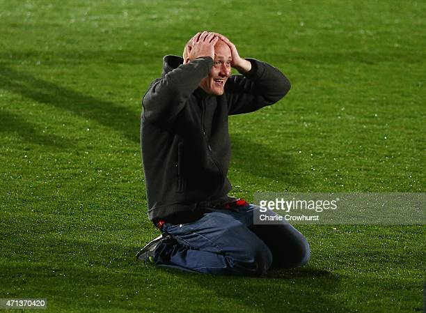 A fan reacts as he celebrates victory on the pitch after the Sky Bet Championship match between AFC Bournemouth and Bolton Wanderers at Goldsands...