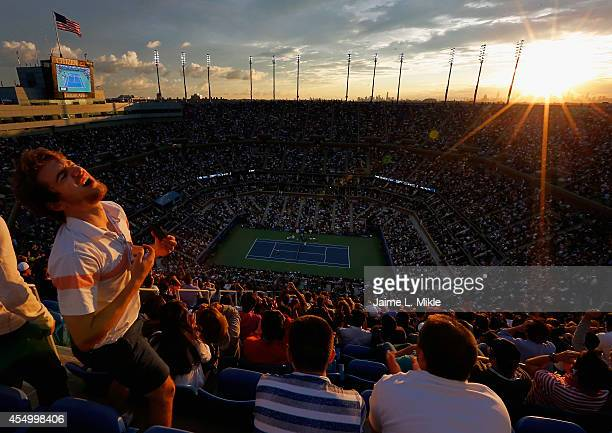 A fan reacts as Marin Cilic of Croatia plays against Kei Nishikori of Japan during their men's singles final match on Day Fifteen of the 2014 US Open...