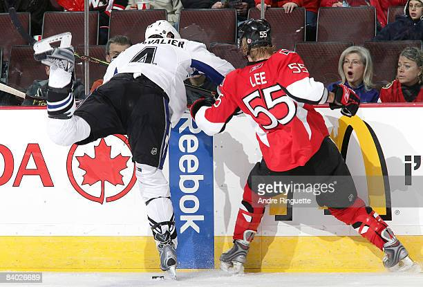 A fan reacts to a collision between Brian Lee of the Ottawa Senators and Vincent Lecavalier of the Tampa Bay Lightning at Scotiabank Place on...