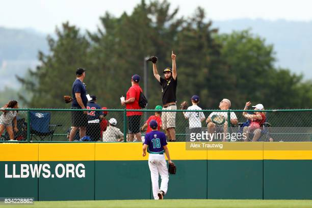 A fan reacts to a home run during Game 3 of the 2017 Little League World Series between the Canada team from British Columbia and the Europe Africa...