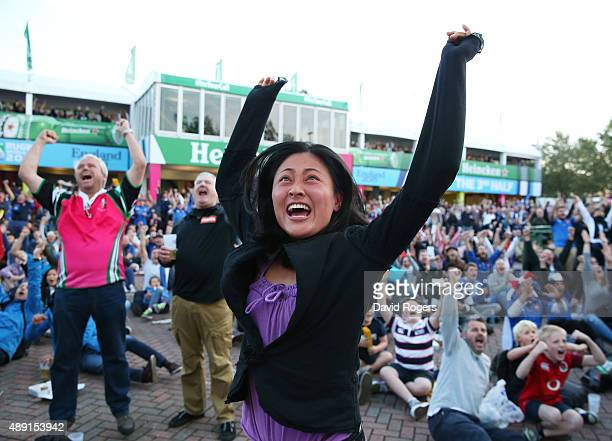 A fan reacts to the Japan victory over South Africa before watching the 2015 Rugby World Cup Pool D match between France and Italy at Twickenham...