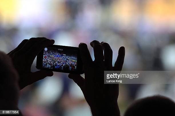 A fan records a video with their smartphone during the game between the Villanova Wildcats and the Oklahoma Sooners during the 2016 NCAA Men's Final...
