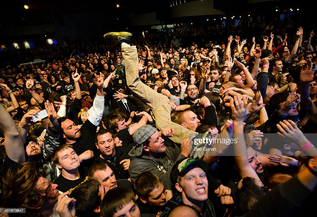 A fan rides the crowd as Megadeth performs at the Myth Nightclub on November 23, 2013 in St. Paul, Minnesota. It was their first stop as part of their new Super Collider Tour.