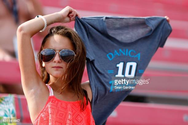 A fan roots for Danica Patrick driver of the Code 3 Associates Ford during the Monster Energy NASCAR Cup Series Pure Michigan 400 at Michigan...