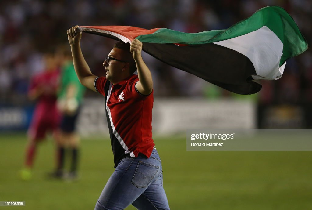 A fan runs on the field during a Guinness International Champions Cup 2014 match between AS Roma and Real Madrid at Cotton Bowl on July 29, 2014 in Dallas, Texas.