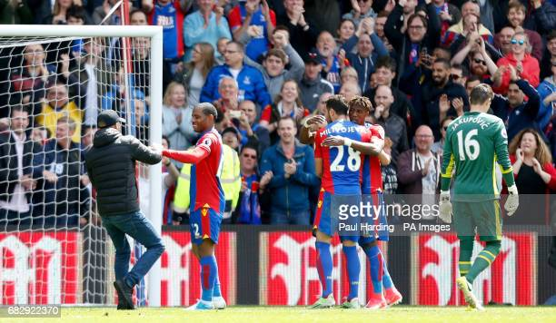 A fan runs onto the pitch atfer Crystal Palace's Patrick van Aanholt scores his sides fourth goal of the game during the Premier League match at...