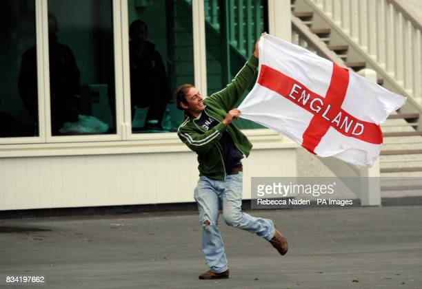 A fan runs past the England dressing room with a flag during the match at the University Oval Otago University New Zealand