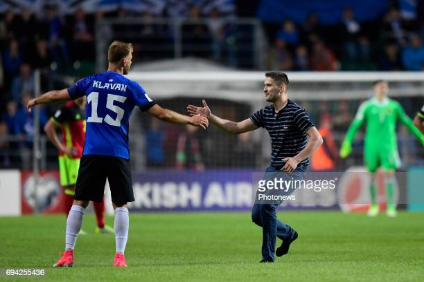 A fan runs up the pitch to shake hands with Ragnar Klavan defender of Estonia during the World Cup Qualifier Group H match between Estonia and...