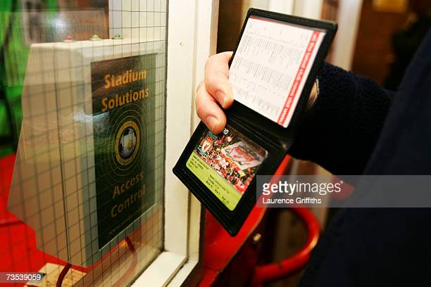 A fan scans a ticket before the Barclays Premiership match between Liverpool and Sheffield United at Anfield on February 24 2007 in Liverpool England