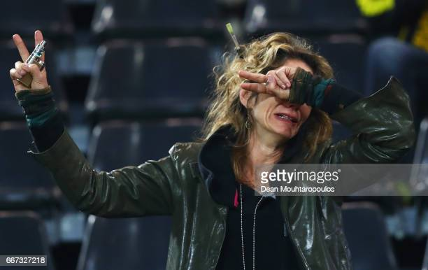 A fan shows her emotions after the postponement of the game prior to the UEFA Champions League Quarter Final first leg match between Borussia...