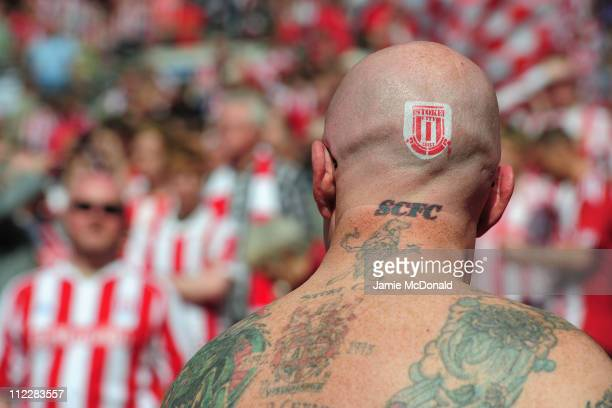 A fan shows his Stoke City tattoos during the FA Cup sponsored by EON semi final match between Bolton Wanderers and Stoke City at Wembley Stadium on...