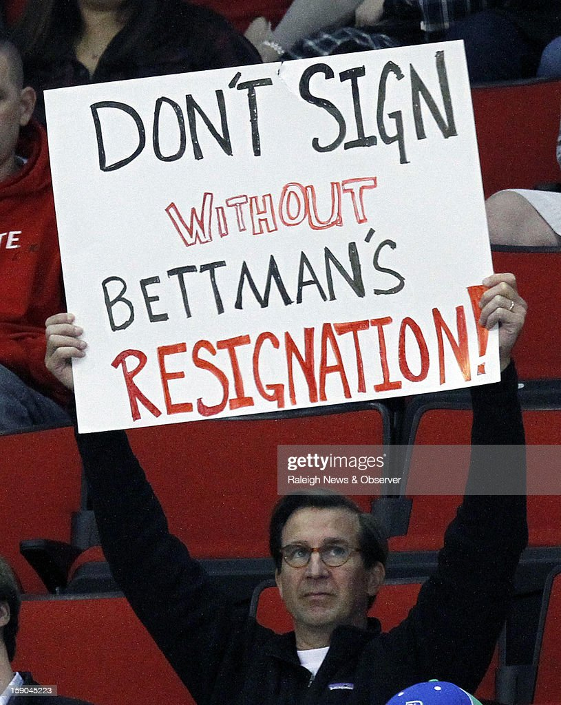 A fan shows holds up a sign showing his displeasure with NHL commissioner Gary Bettman while the Charlotte Checkers play the Norfolk Admirals in a American Hockey League hockey game at the PNC Arena on Sunday, January 6, 2013, in Raleigh, North Carolina. The Checkers are the Carolina Hurricanes highest-level minor league franchise. The NHL announced an agreement with the players union on the lockout Sunday.