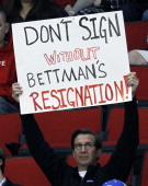 A fan shows holds up a sign showing his displeasure with NHL commissioner Gary Bettman while the Charlotte Checkers play the Norfolk Admirals in a...