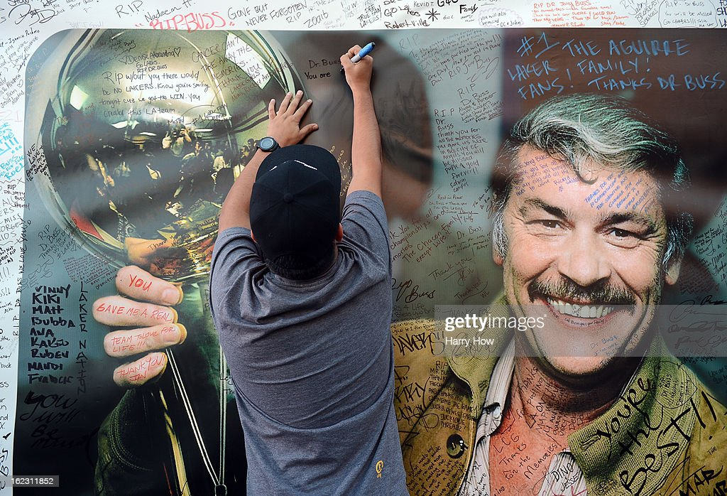 A fan signs the display of Dr. Jerry Buss after his memorail service outside the Nokia Theatre L.A. Live on February 21, 2013 in Los Angeles, California.
