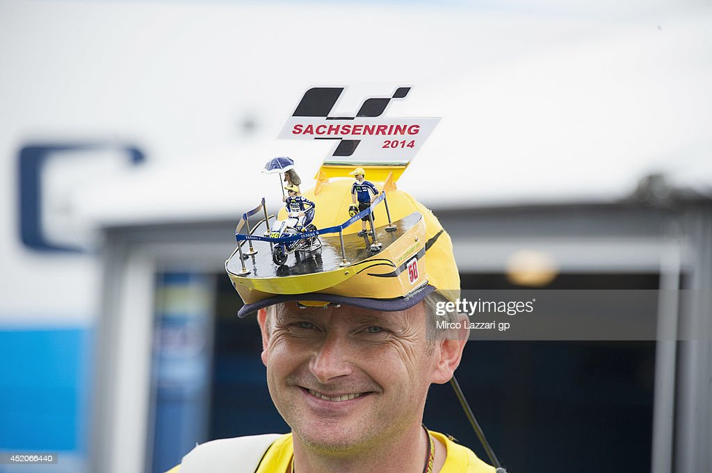 A fan smiles in paddock with a special cap from Sachsenring circuit during the MotoGp of Germany Qualifying at Sachsenring Circuit on July 12 2014 in...
