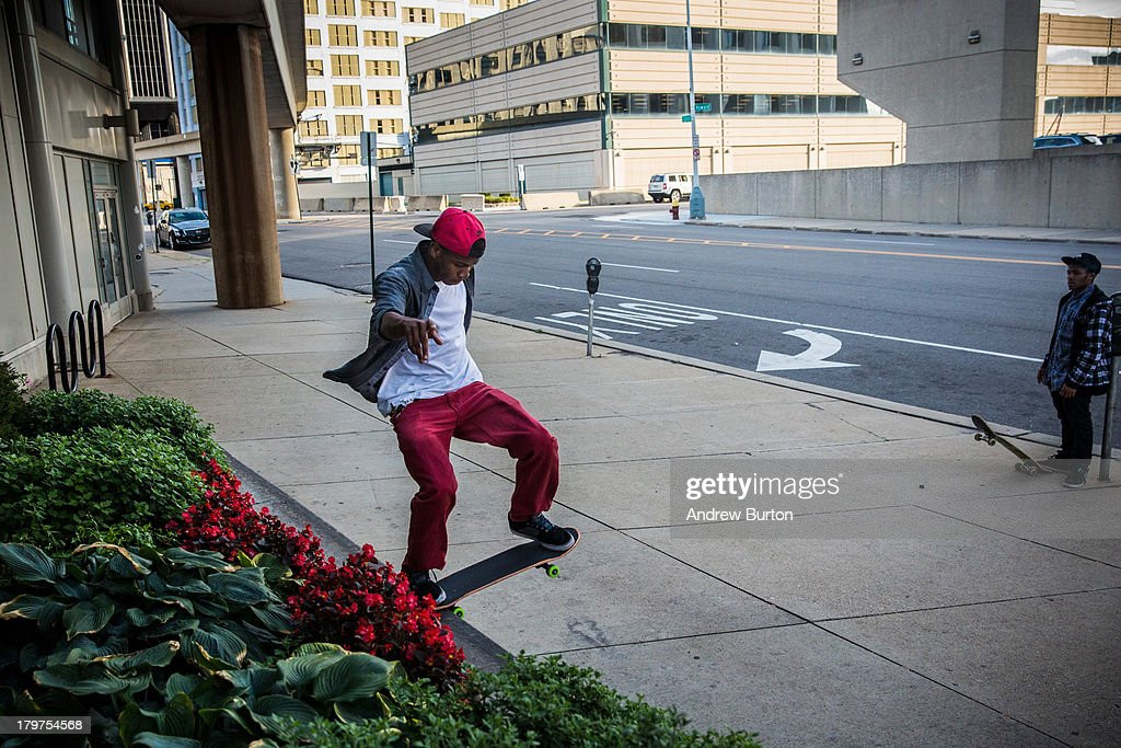 Fan Smith, a skateboarder, grinds on a ledge on September 6, 2013 in Detroit, Michigan. Detroit is struggling with over 78,000 abandoned homes across 140 square miles and 16% unemployment; in July, the city declared bankruptcy.