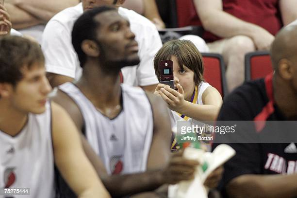 A fan snaps a photo of Greg Oden of the Portland Trail Blazers during the game against the Dallas Mavericks during the NBA Summer League on July 8...