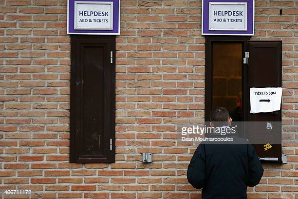 Fan speaks to a staff member at the help desk outside the stadium prior to the UEFA Youth League quarter final match between RSC Anderlecht and FC...