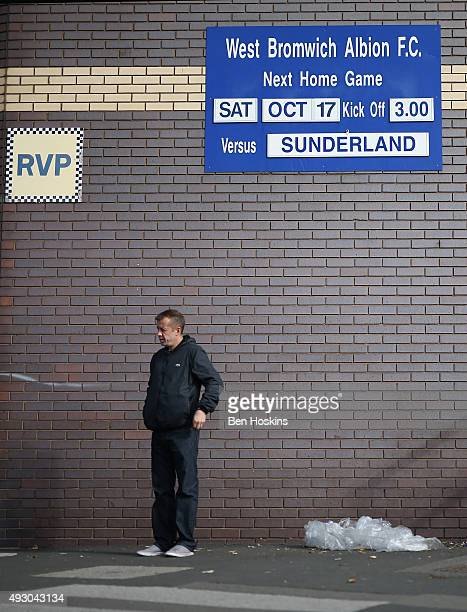 A fan stands in front of the fixture board prior to the Barclays Premier League match between West Bromwich Albion and Sunderland at The Hawthorns on...