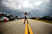 A fan stands in the infield prior to the NASCAR Sprint Cup Series Coke Zero 400 at Daytona International Speedway on July 5 2014 in Daytona Beach...