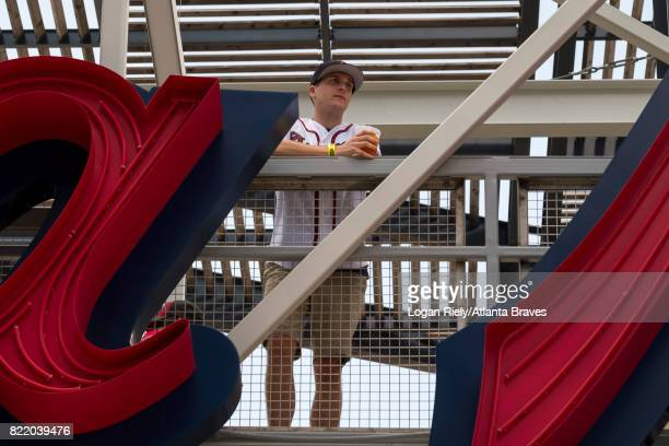 A fan stands on the bridge in Fan Plaza before the game against the Miami Marlins at SunTrust Park on June 17 2017 in Atlanta Georgia The Braves won...