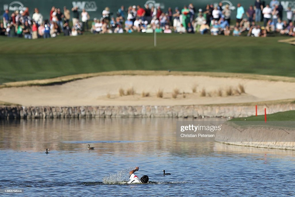 A fan swims the length of the pond on the 18th green during the final round of the Waste Management Phoenix Open at TPC Scottsdale on February 5, 2012 in Scottsdale, Arizona.