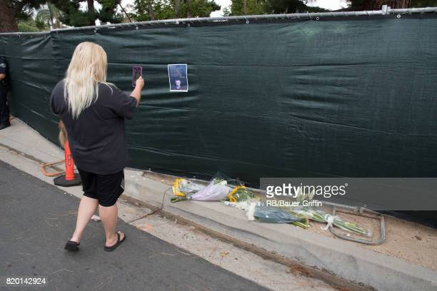 A fan takes a photo near tributes outside the house of Linkin Park's lead singer Chester Bennington after the frontman's reported suicide on July 20...