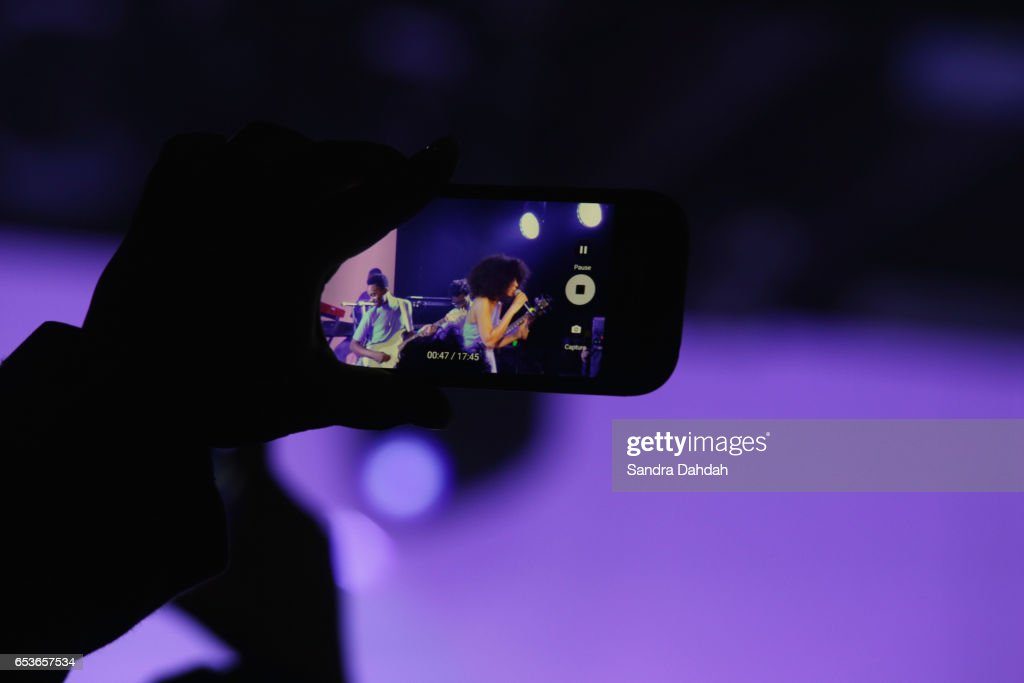 A fan takes a photo of Solange as she performs onstage at the YouTube music showcase during 2017 SXSW Conference and Festivals on March 15, 2017 in Austin, Texas.