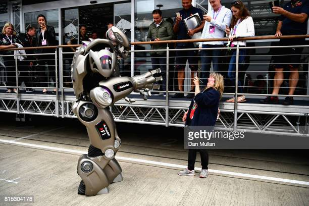 A fan takes a photo of Titan the Robot outside the Red Bull Racing Energy Station during the Formula One Grand Prix of Great Britain at Silverstone...