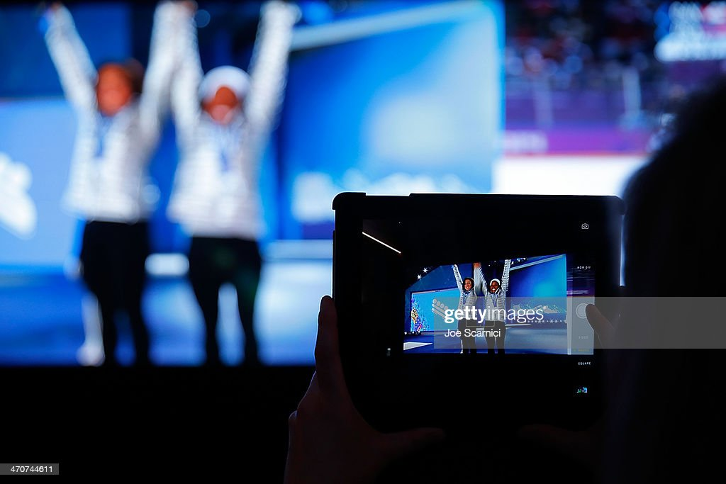 A fan takes a photo with an iPad at the USA House in the Olympic Village on February 20 2014 in Sochi Russia