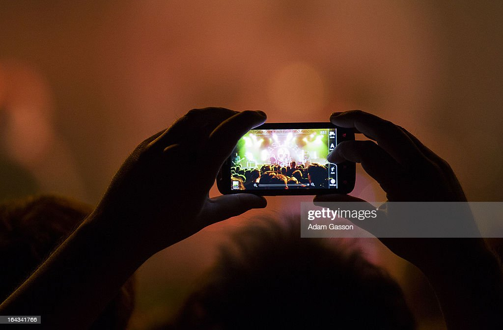 A fan takes a photograph on their mobile phone as The Gaslight Anthem perform at O2 Academy on March 22, 2013 in Bristol, England.