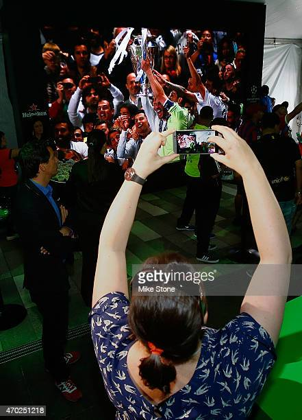 A fan takes a picture during the 2015 UEFA Champions League Trophy Tour presented by Heineken exhibition on April 18 2015 in Dallas Texas