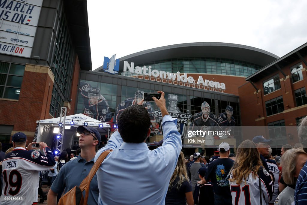 A fan takes a picture of the entrance to Nationwide Arena prior to the start of the game between the Columbus Blue Jackets and the Pittsburgh Penguins in Game Three of the Eastern Conference First Round during the 2017 NHL Stanley Cup Playoffs on April 16, 2017 at Nationwide Arena in Columbus, Ohio.